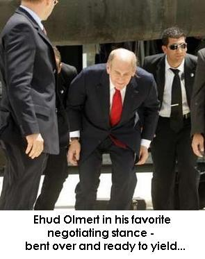 Olmert_bends_over